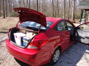 Rental car with partial load of items purchased for outfitting