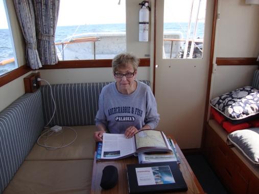 Vicki studies navigation material as we cruise the Atlantic