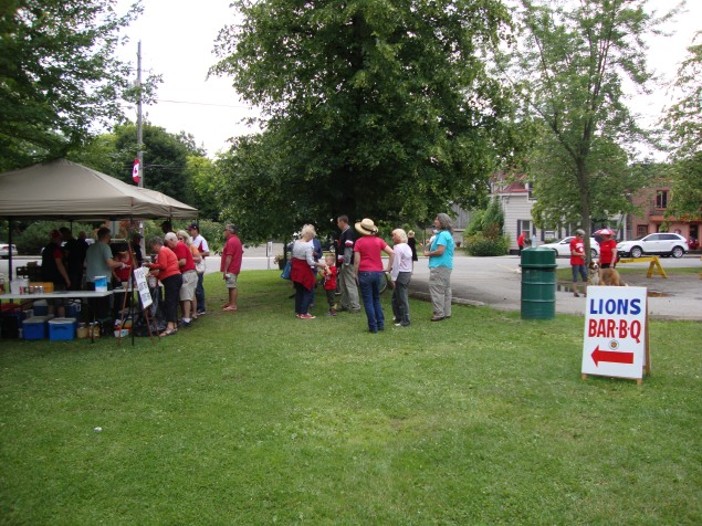 Lions selling hot dogs at Canada Day Celebration -  At Park next to where we were moored.