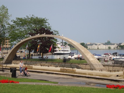 Our tour boat to the 1000 Islands from Kingston, Ontario framed by the arch in the Kingston City Waterfront Park