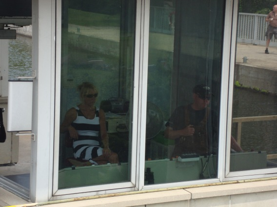 Peterborough Lift Lock operator with guest in control room.