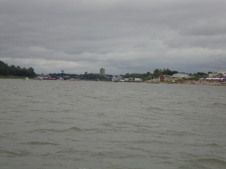 Where the Tennessee River meets the Ohio River.  The crowed gathered  on the bank to the right is watching a canoe race.