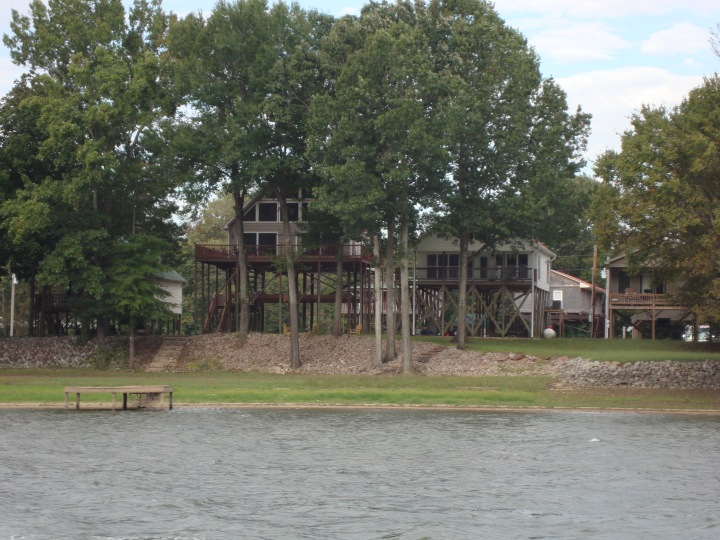 Houses along the river bank on stilts for flood protection