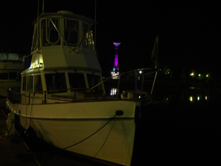"""Night time in Florence Harbor Marina.  This """"Lighthouse"""" at the harbor entrance was lit up and changed to every color of the rainbow."""