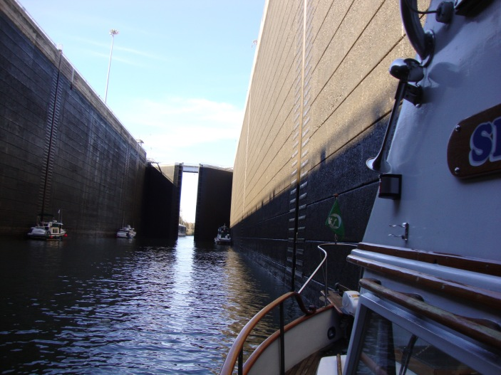 The water stops dropping and the gates begin to open.  Look at the size of the boats there in the bottom.  This is one big lock!