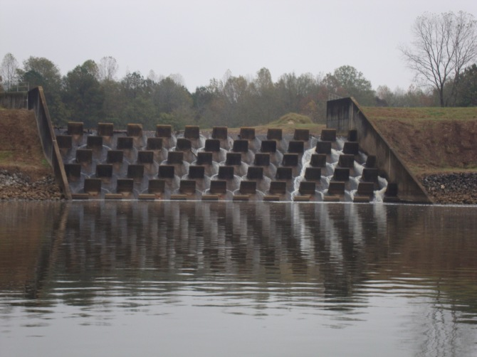 These spillways diffuse the water and cause it to enter the canal with little effect.